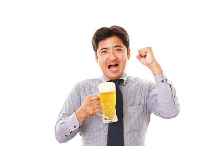 salaried: Man drinking beer Stock Photo