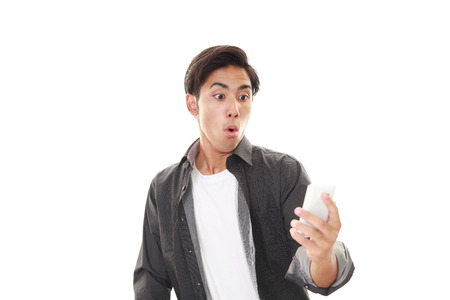 Surprised Asian man Stock Photo