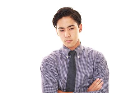 Depressed Asian businessman. 免版税图像