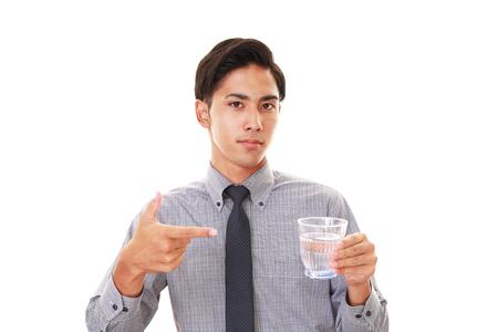 liveliness: Man drinking water Stock Photo