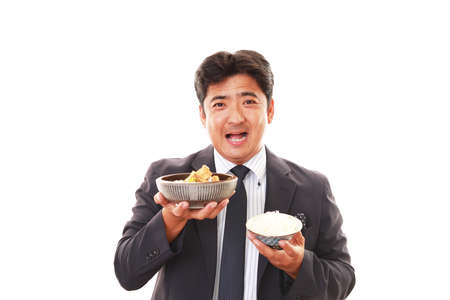 liveliness: The man who eats food Stock Photo