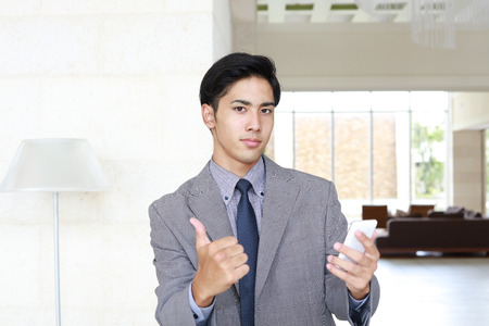 telephone salesman: Business man showing thumbs up sign