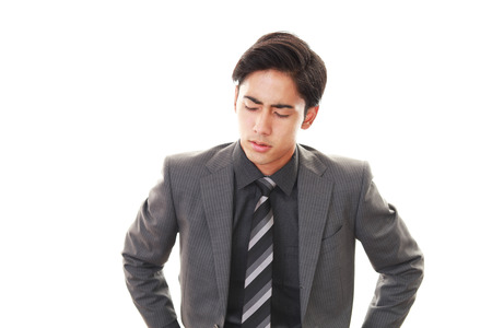 Tired Asian businessman