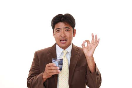 salaried worker: Man drinking water Stock Photo