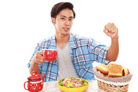 asian man face: Asian man having breakfast