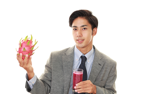 salaried: Man drinking a glass of juice