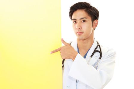Smiling Asian medical doctor 写真素材