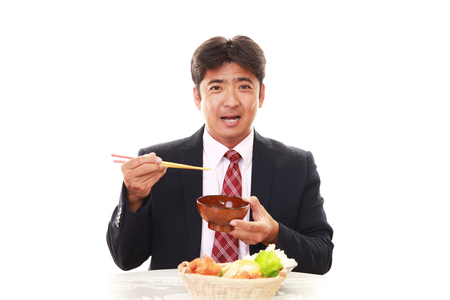 liveliness: Happy man eating meals Stock Photo