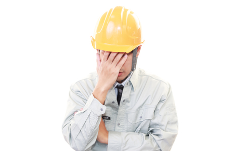 asian man face: Disappointed Asian worker