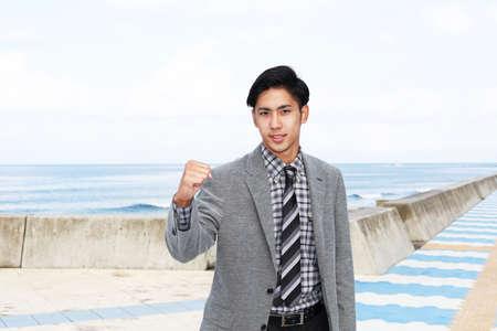 salaried worker: Smiling Asian businessman