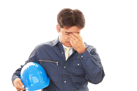 male headache: Worker having a headache