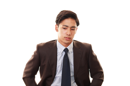 asian man face: Disappointed Asian businessman