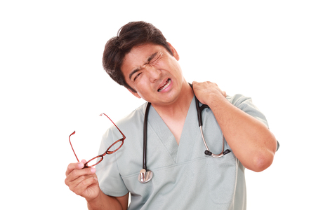 health professionals: Portrait of an overworked and tired Asian doctor Stock Photo