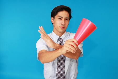spectating: Man shows the sign of prohibition Stock Photo