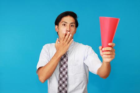 spectating: Surprised Asian man Stock Photo