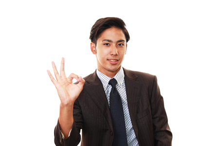 gives: Businessman gives OK sign Stock Photo