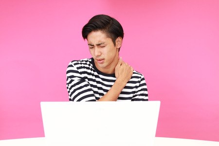 working stiff: Asian man having a shoulder pain