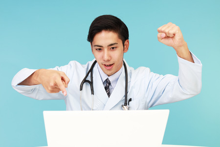 pc: Doctor working on PC Stock Photo
