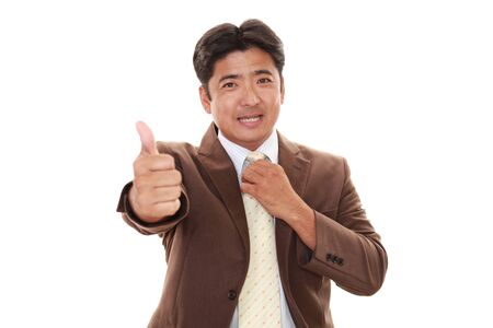 liveliness: Asian business man showing thumbs up sign