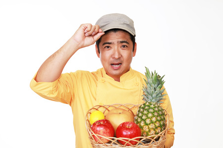 asian chef: Smiling Asian chef with fruits