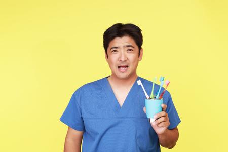 hygienist: Smiling Dental hygienist