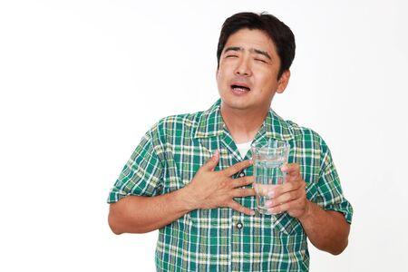 man drinking water: Man drinking water.
