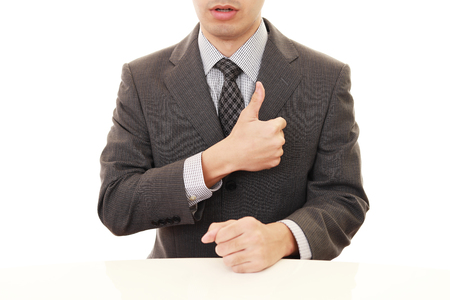 bodypart: Business man showing thumbs up sign