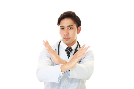 Asian doctor shows the sign of prohibition 스톡 콘텐츠