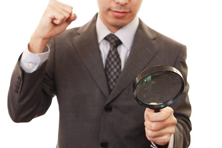 magnifying glass man: Man with a magnifying glass Stock Photo
