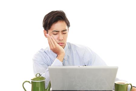 tired businessman: Tired Asian businessman