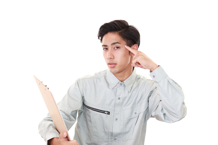 unhappy man: Tired and stressed Asian worker Stock Photo
