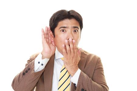 hark: Surprised Asian businessman