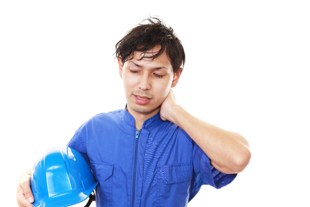 tired: Tired Asian worker Stock Photo