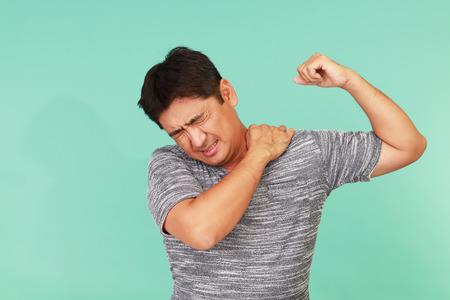 working stiff: Asian man having a shoulder pain