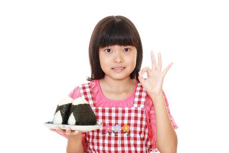 gir: Smiling Asian gir eating rice.