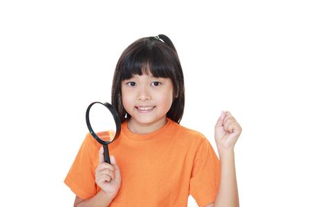 Beautiful Asian girl looking through a magnifying glass.