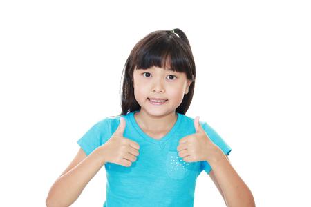 okay: Smiling Asian girl doing okay gesture.