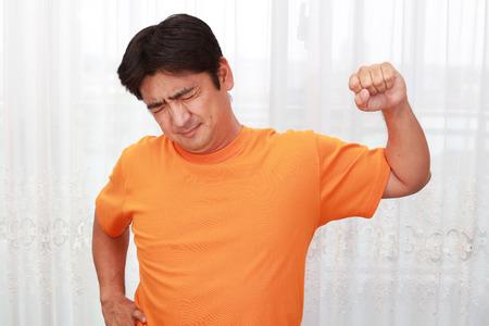 Asian man having a shoulder pain