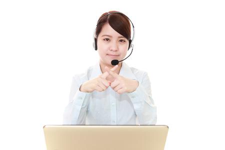 Call center operator demonstrating prohibiting gesture