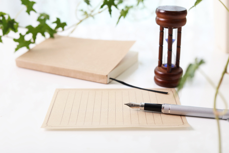 Notebook, pen and hourglass. Stock Photo - 67032904