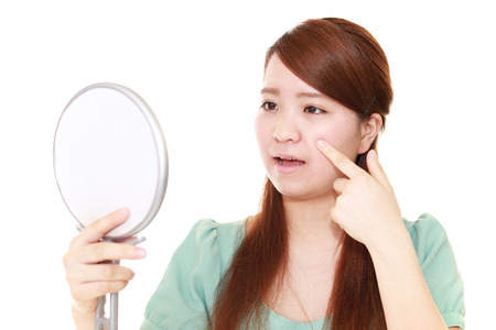 uneasy: Woman with an uneasy look. Stock Photo