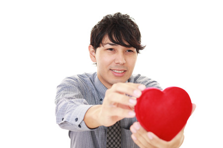 Smiling man with a red heart Stock Photo
