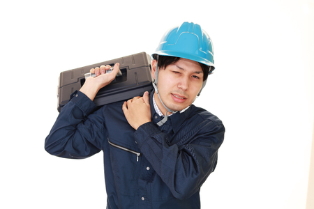 Portrait of a worker with shoulder pain