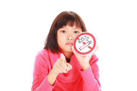 Girl holds non smoking sign