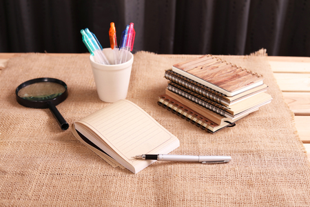 necessities: Notepad and pen Stock Photo