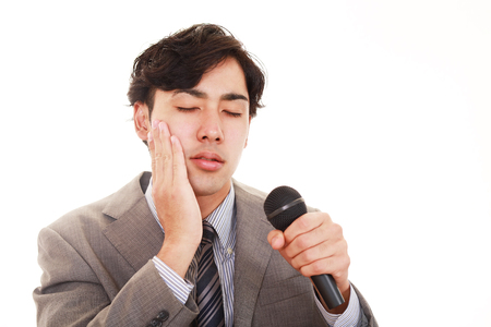 tired businessman: A businessman giving his presentation. Stock Photo