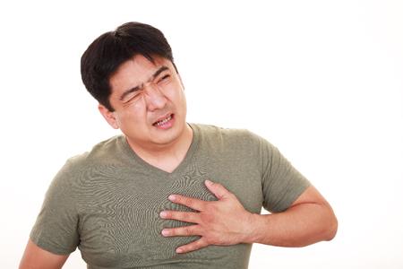 Man having a heart attack Stock Photo