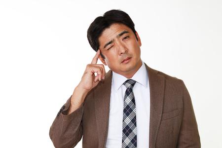 salarios: Retrato de hombre de negocios mirando incómodo Foto de archivo