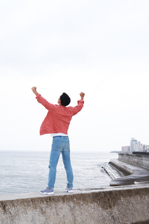 liveliness: Relaxed young man by the sea Stock Photo