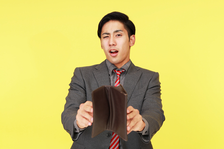 tired businessman: Disappointed Asian businessman